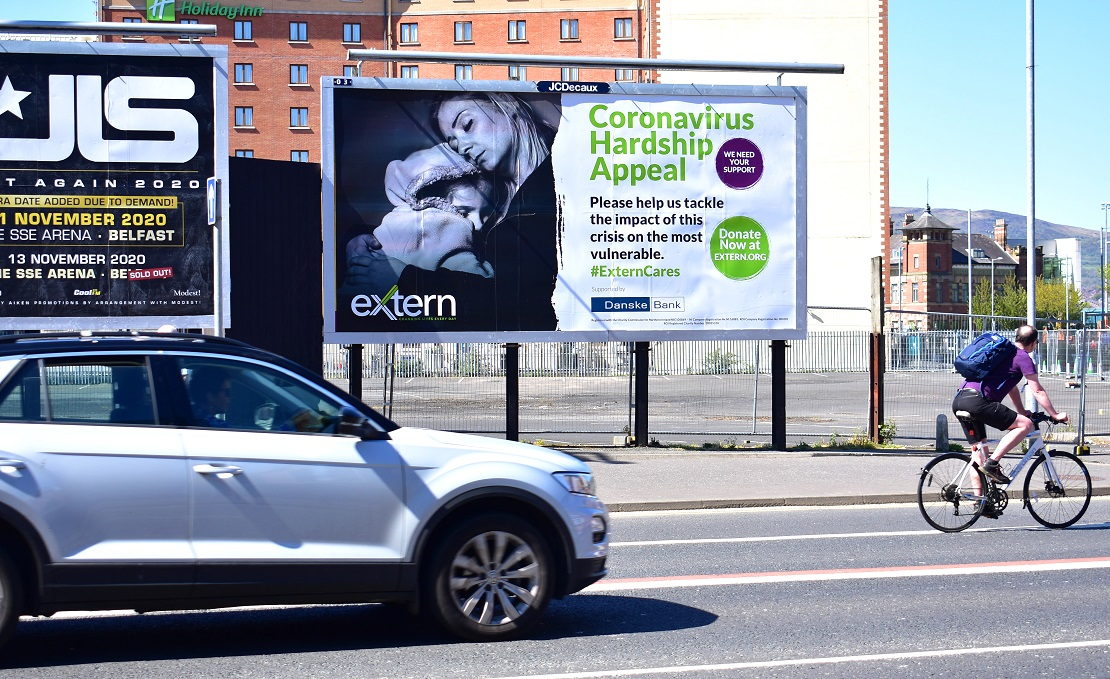 Image shows a large billboard ad for Extern's Coronavirus Hardship Appeal, supported by Danske Bank.